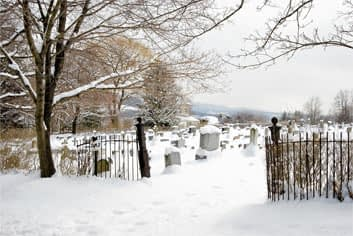 photograph of a graveyard in the snow