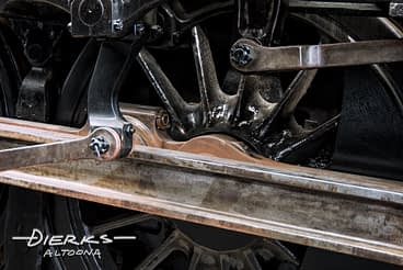 Main drive rod and wheel of a steam locomotive, Norfolk and Western #1218 at the museuem in Roanoke, Virginia.