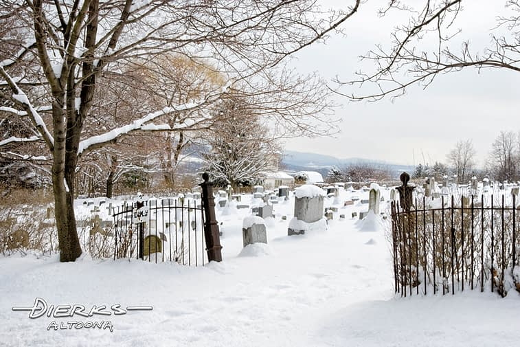 Peaceful cemetery in winter snow and sunlight.