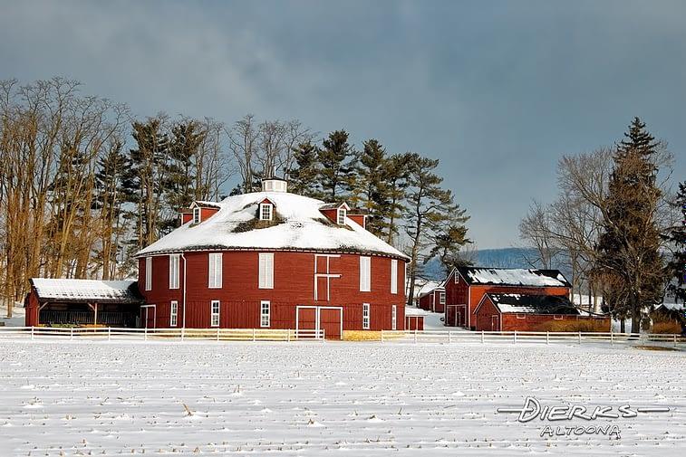 A round barn in sunny winter snow near Centre Hall, Pennsylvania.