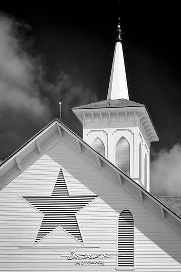 The Star Barn steeple and star in a back and white close-up, classic Gothic Revival architecture.