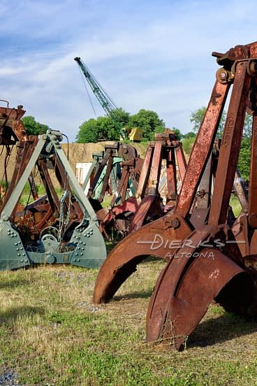 Crane Buckets for Digging with a Bucyrus Erie Machine in the Background