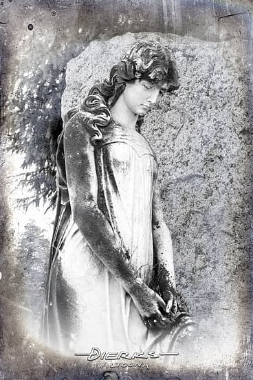 A cemetery statue of beautiful young girl in a country graveyard in New York state.