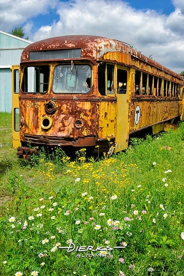 The Daisy Street trolley sits rusting in retirement; it's an old PCC car from the Boston T Line.