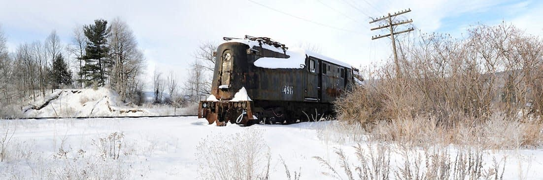 panoramic photo of a train in the snow