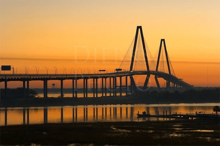photo of a bridge spanning a body of water at twilight