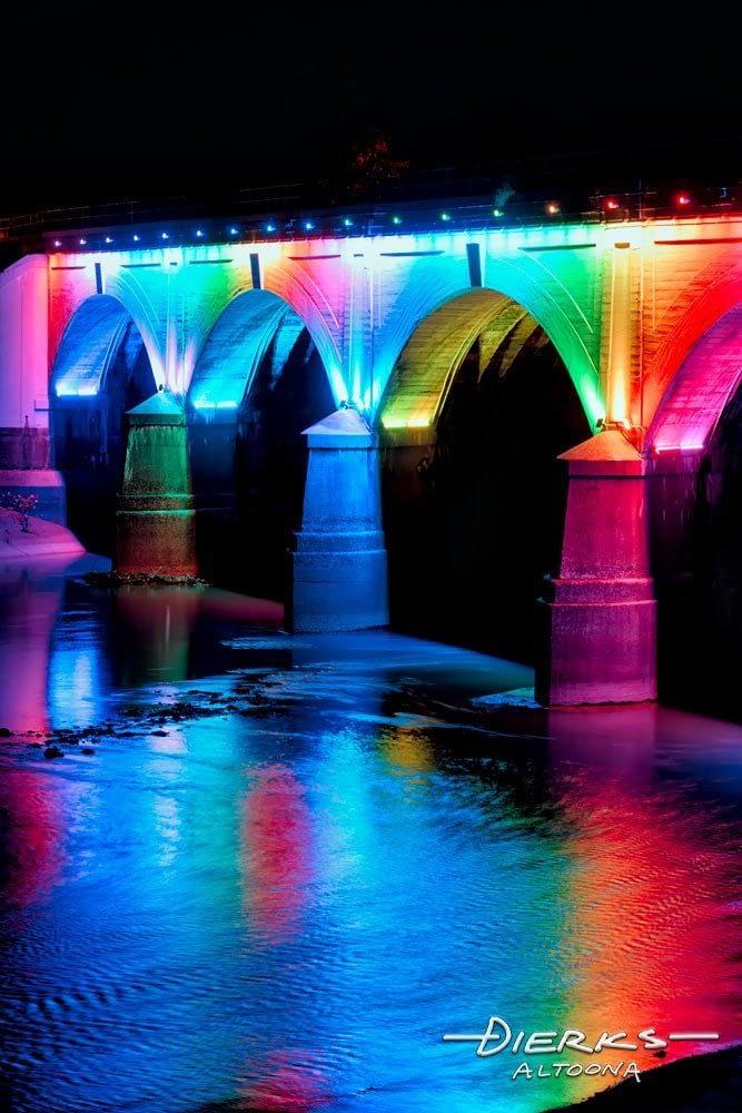 Bridge at Johnstown PA iluminated at night in rainbow colors.
