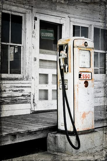 Vintage Esso gas pump in black and white.
