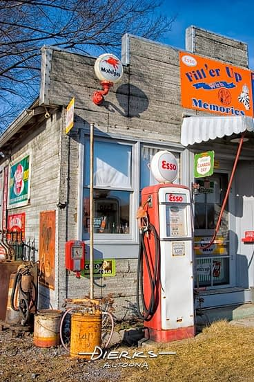 An old country store coverted to selling gas station memorabilia, with a classic Esso gas pump.
