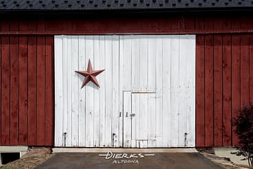 Metal star barn hex sign on an older barn repainted and reconditioned with a new roof.